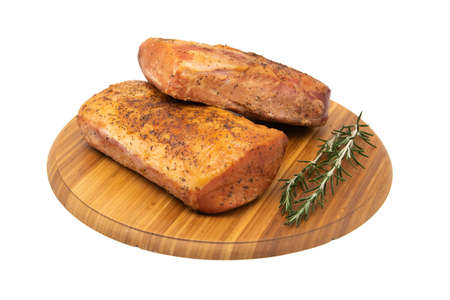 Smoked ham on a rustic wooden board with fresh rosemary. 스톡 콘텐츠