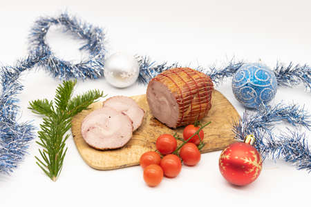 Smoked Turkey roll with herbs on a Christmas wooden background. 스톡 콘텐츠