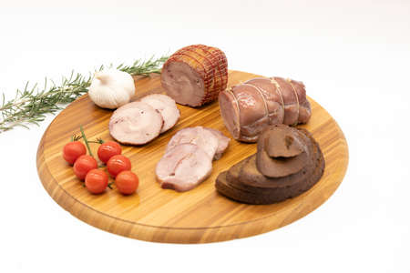 Smoked and baked Turkey roll with herbs on a wooden background.