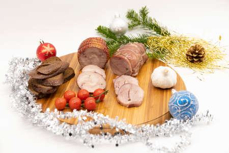 Smoked and baked turkey roll with herbs on a Christmas wooden background.