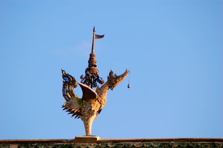 A sculpture of bird decorate on the temples  roof