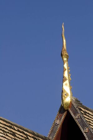 apex: The elongated and elaborately carved apex of the gable of a Buddhist temple