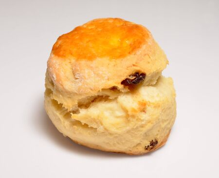 Isolate raisin cheese scone, a side view close up photo image of raisin cheese scone isolate on white background present a detail on a side view of raisin cheese scone