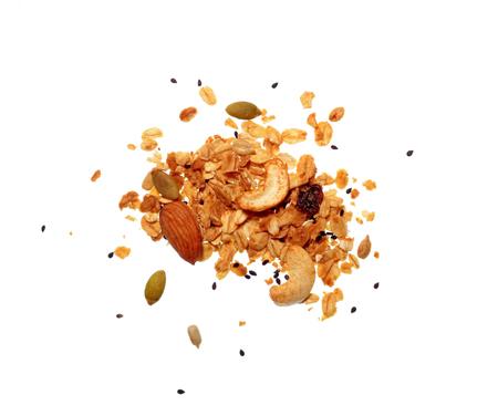 Isolate granola/muesli grain, a top view close photo on granola/muesli pile present a detail in top view of granola/muesli grain isolate on white bright light background, a cereal grain healthy food Standard-Bild