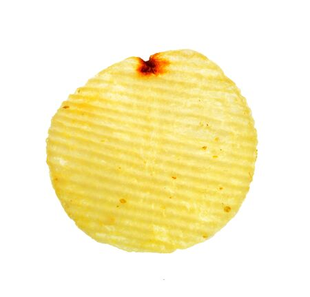 Isolate potato chip, a closeup photo image of potato chip isolate on white background present a detail of ridge pattern on a surface of potato chip Stock Photo