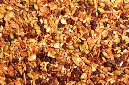 Granola texture, muesli texture, a top view close photo image on granola or muesli pile present a detail in top view of granola or muesli texture, a cereal grain healthy food, can use for background