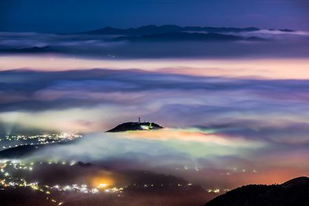 Mountain sea of clouds, colorful glazing night in Taipei, Taiwan.