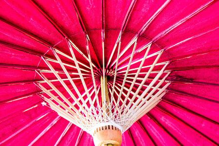 Red bamboo hand made umbrella photo
