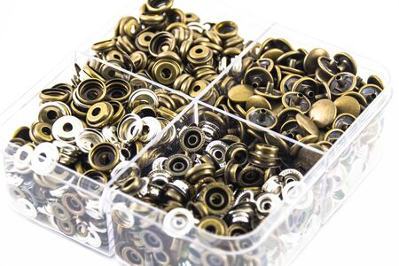 sewing box: Metal sewing buttons in plastic box Stock Photo
