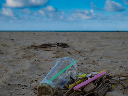 defilement: Garbage on the beach trash ,plastic ,bottle ,foam ,rubbish has pollute.selective focus Stock Photo
