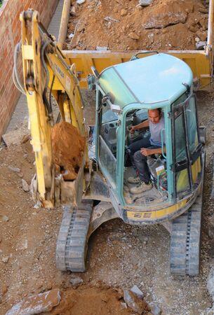 Hydraulic excavator doing earthmoving work