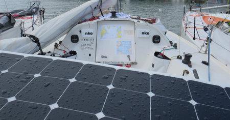 Martinique, France, November 23, 2019: skipper bow participant in the ocean voyage alone. Race Mini Transat Solar panel as energy.Renewable energy
