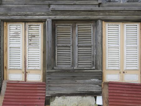 Typical wooden house in Martinique, French West Indies. Tropical wooden windows. Stockfoto