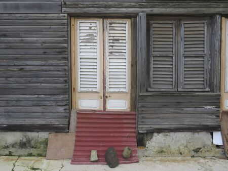 Typical wooden facade in Martinique, French West Indies. Tropical wooden windows. Imagens