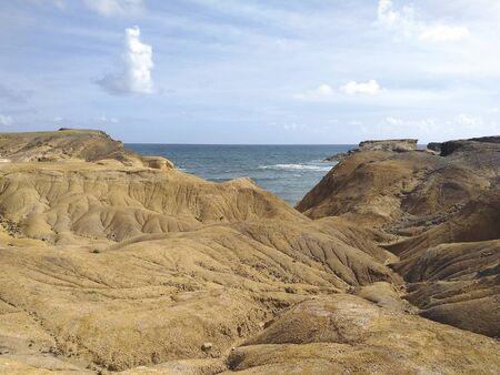 Tropical landscape of volcanic rock by the Caribbean Sea. Caribbean desert. Savanna of Petrification.