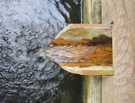 Detail of water falling in rural watering hole Stockfoto
