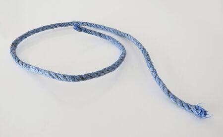 Isolated blue nautical rope on white background.