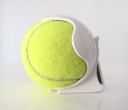 Isolated Tennis ball with white plastic clip-On Tennis Ball Holder. White background.