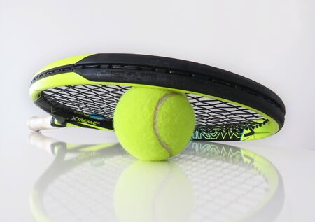 Martinique, January, 7 2010: Tennis ball and racket on white background