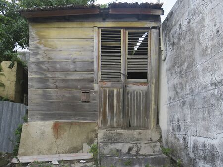 Old and rusted wooden Caribbean house. Exterior of a tropical house.