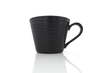 Isolated black porcelain cup on white background Stockfoto