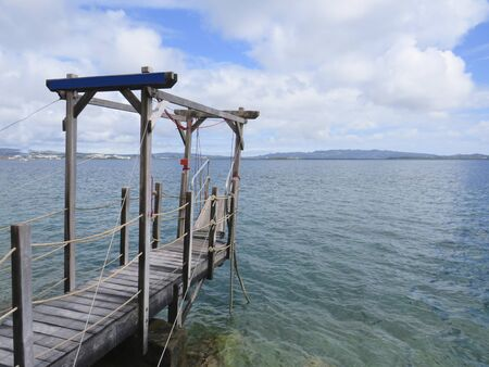 Small wooden jetty over the Caribbean sea. Idyllic tropical landscape.