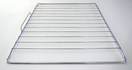 Stainless Steel baking Rack isolated on white background. Close-up of a wire rack.