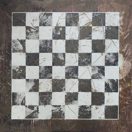 Front view of chess board made in stone. Old image. Standard-Bild
