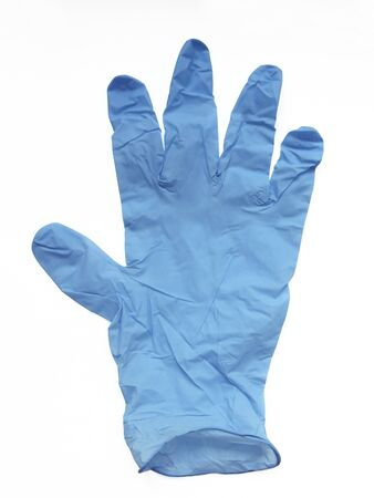 Vertical overhead view of durable, blue disposable surgical latex glove isolated on white background. Protection against harmful substances, viruses and food handling. Banque d'images
