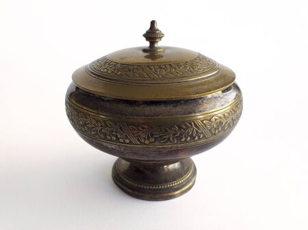 Carved bronze bowl with lid isolated on white background. Oriental style. Front view. 版權商用圖片