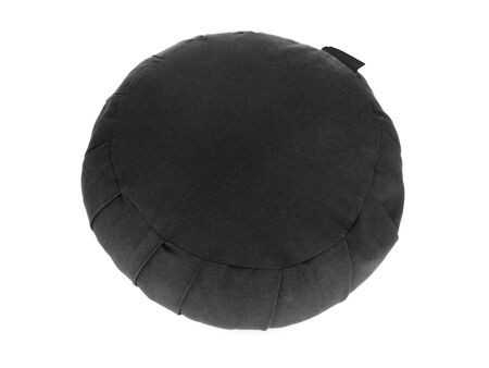 Round black cushion isolated on white background. Traditional Japanese cushion for meditation and yoga with high quality natural fibers. Known as
