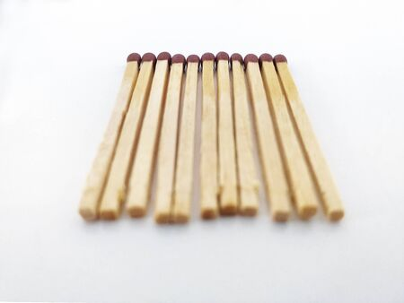 Perspective view of Piles of brown matchstick isolated on white. Wooden rods with a flammable head used to light a fire.