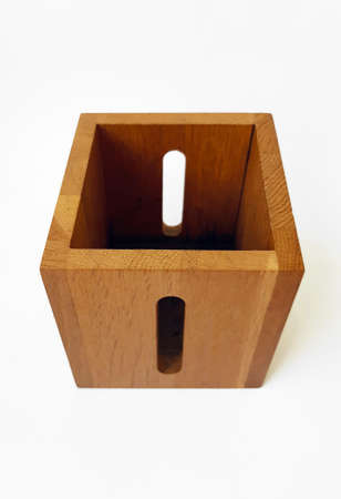 Aerial view of square solid wood box isolated on white background. Exquisite finish wooden goblet, practical design, ideal as a pencil holder or desk organizer.