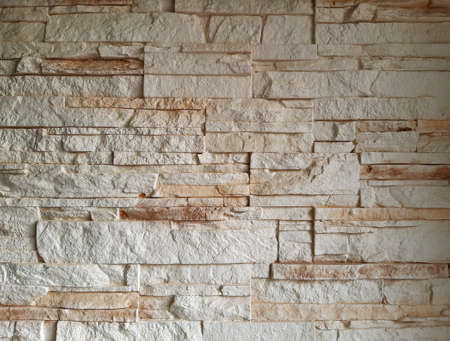 Vintage brick wall texture background. Wallpaper with modern design simulating an ivory-white brick trompe l'oeil. Stone works. Abstract Architecture detail.