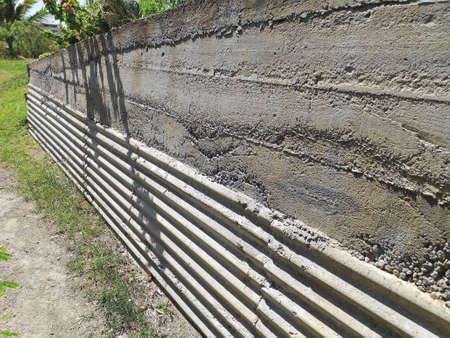 Concrete wall in perspective. Old cement fence with two finished textures in natural environment. Construction and Architecture pattern and texture.