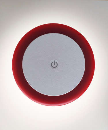 Aerial view of on and off button of red Touch Table Lamp isolated on white background. Interior lighting and home decoration design object.