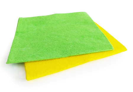 Pair of square yellow and green cloths isolated on white background. Multipurpose anti-bacteria cleaning rag and dust trap. Close up of Disposable and ecological accessory for cleaning all surfaces.