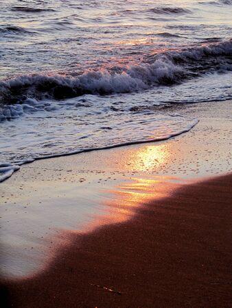 Waves on the seashore at sunset                              photo