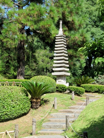 Japanese stone tower  in a garden in the summe                                photo
