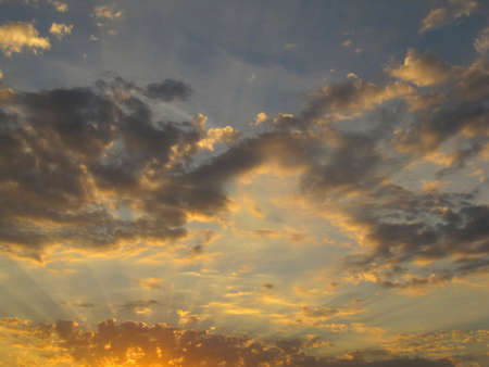 Picturesque cloudy sky in sunshine on a sunset photo