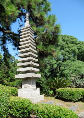 Japanese garden in the summer, stone traditional tower                                photo