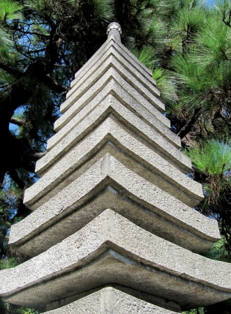 Japanese stone tower in a garden close up                                 photo
