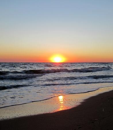 Beautiful gentle sea on a sunset                                photo