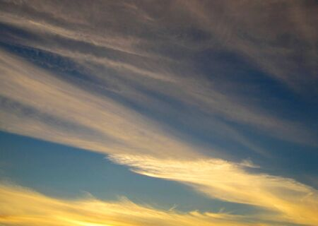 Beautiful cloudy sky on a sunset photo