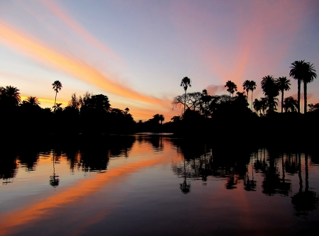 Sunset in tropical paradise and reflection in water Stock Photo