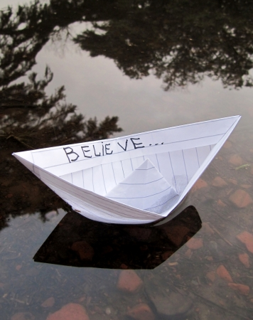 Paper boat on water  Concept Believe in Dream