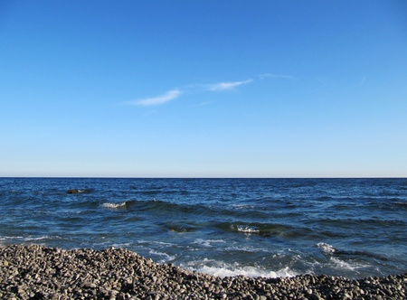 Beautiful wavy sea and blue sky                                photo