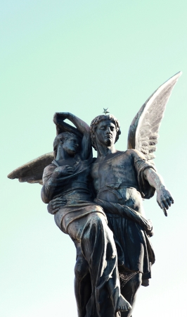 Symbolical statue Guardian angel rescuing the woman  photo