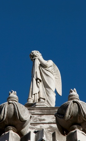 Guardian angel female statue against the sky  photo