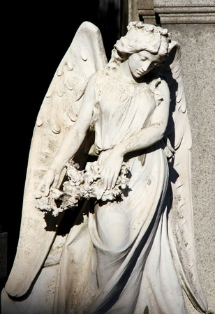 Sad Guardian Angel beautiful female statue  Stock Photo